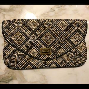 Handbags - Straw woven clutch Geo pattern